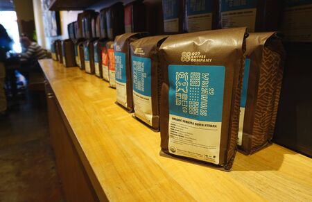 Boulder, CO, USA - May 11, 2019 - Display of coffee packs from Colorado local business Ozo Coffee Company, on their Pearl Street location. Éditoriale