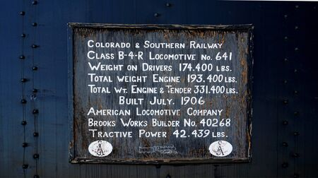 Leadville, CO, USA, July 14, 2018 - Sign describing the specifications of the 1906 Colorado and Southern Railway Class B-4-R Locomotive No 641 from the American Locomotive Company, on display at the Leadville & Southern train station