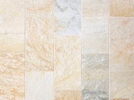 Texture - Rectangular porcelain tile with stone look in multiple colors with shades of blue, brown and red colors.