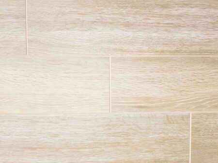 Texture - Rectangular ceramic or porcelain tile in beige tones simulating wood grain with visible light colored grout between tiles.