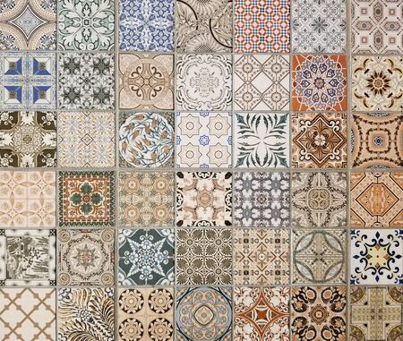 Texture - Array of colorful Mediterranean style square ceramic tiles with many shades of blue, red, brown, beige and different abstract patterns for a rustic look.