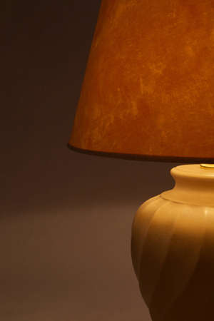 drowsiness: a lighted lamp on a gray background