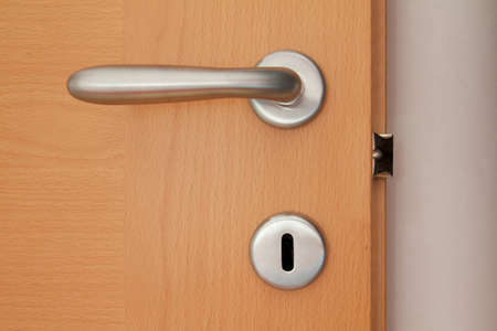 categorical: gray handle of a wooden door Stock Photo