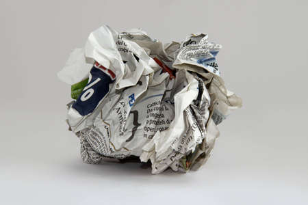 ball of crumpled paper, on white and round photo