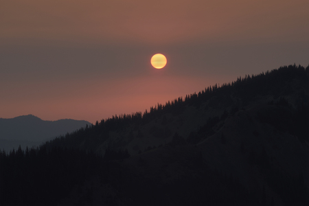 Sunset and Wildfire Haze from the Cirque Rim Trail, Olympic National Park, Washington Фото со стока