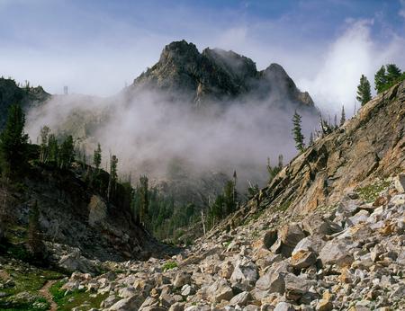 Clearing storm above Sawtooth Lake, Sawtooth Wilderness, Idaho Фото со стока