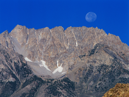 Descending moon in the eastern Sierra Nevada, Owens Valley, California