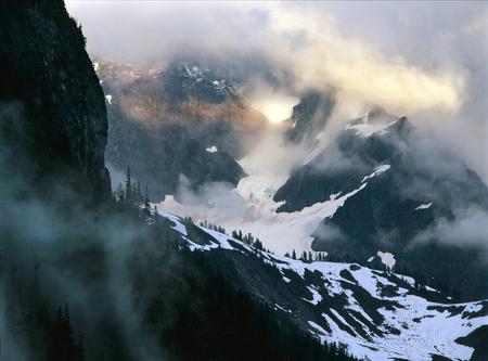 Sunlight through storm clouds, North Cascade Range, Washington