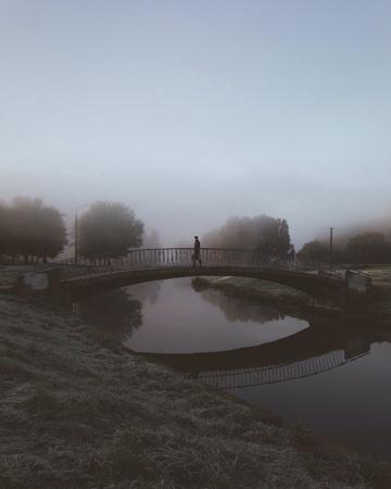 man: Man crossing on the bridge