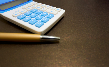 luxuries: calculator and pen Stock Photo