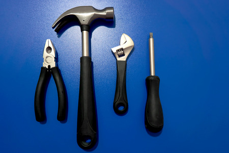 screwdriwer: A set of tools on blue background Stock Photo