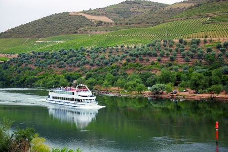 portugal agriculture: Cruise ship at Douro River, Portugal, with the Port wine vineyards in the background