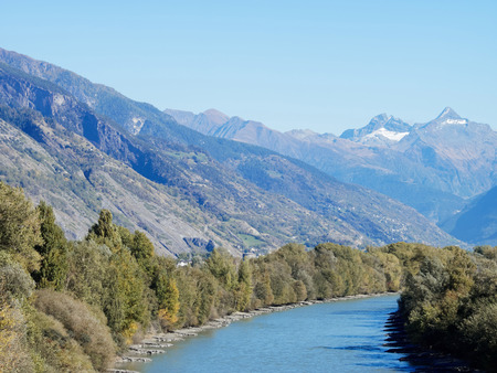 the rhone in wallis flows like an awesome bow between the mountains Reklamní fotografie