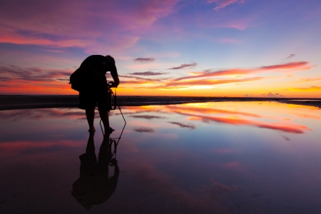 Silhouette of a photographer at sunset Stock Photo - 20415534