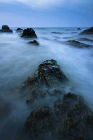 Rock and waves at a beach in Borneo, Sabah, Malaysia photo