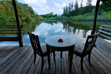 table and chairs with lake view at Sabah, Malaysia photo