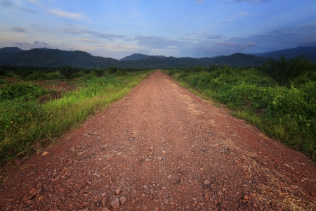 Gravel road leading into hills at Borneo, Sabah, Malaysia photo