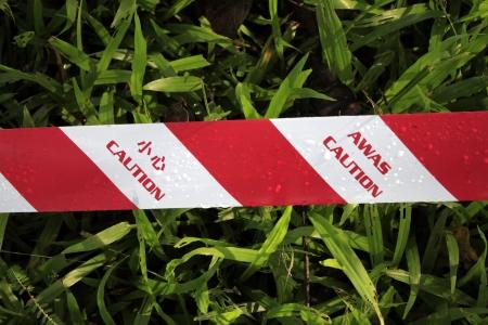 caution tape: Caution tape on grass