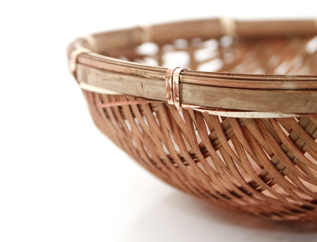 Bamboo basket over white  photo