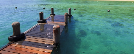 Wooden jetty at a tropical island in Sabah, Borneo, Malaysia photo
