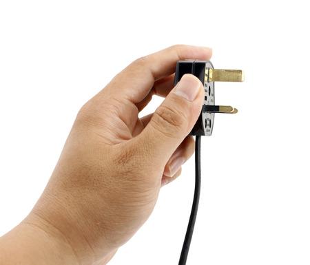 Hand holding electrical plug isolated on white photo