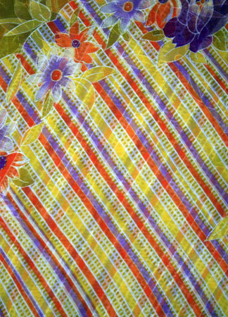 Fabric with floral batik pattern and colored stripes photo