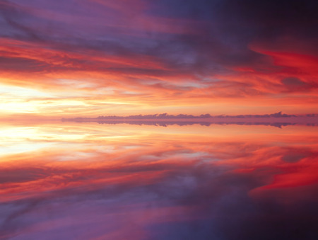 dramatic clouds: Reflection of dramatic and colorful clouds Stock Photo