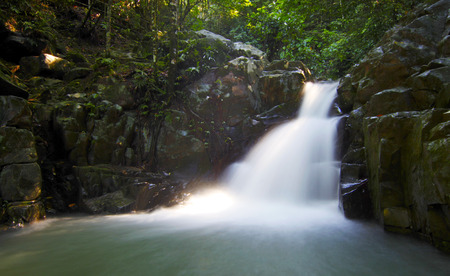 Tropical waterfall at a rainforest in Borneo photo