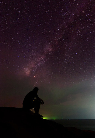 stargazing: Man and the milky way at Sabah, East Malaysia, Borneo (visible noise due to high ISO and wide aperture)