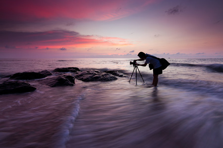 Silhouette of a photographer at sunset in Sabah, Borneo, East Malaysia