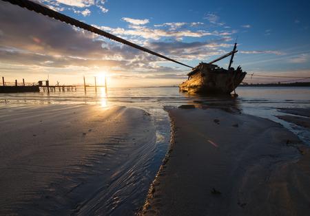 wrecked: Old wrecked ship at sunrise in Kuala Penyu, Sabah, Borneo, East Malaysia
