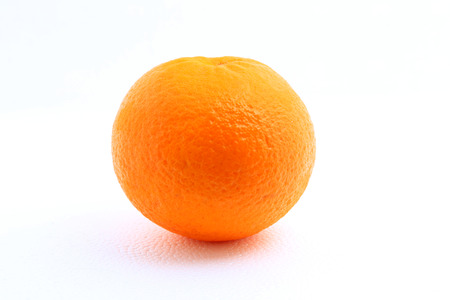 One mandarin orange shot over white background