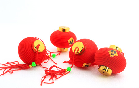 Group of small red Chinese lanterns for decoration over white background.  The chinese word means fortune.