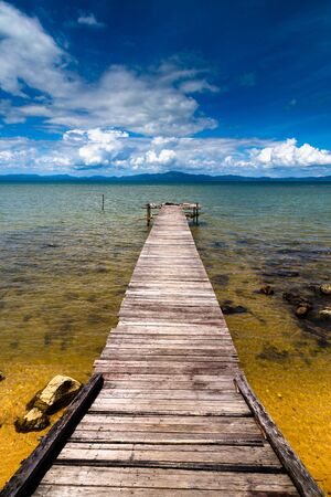 Wooden jetty with beautiful blue sky at Pitas, Sabah, East Malaysia