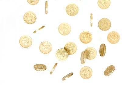 tumbling: pound coins falling and tumbling on a white back ground