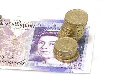 pound coins: british pound coins on top of  a twenty  pound note