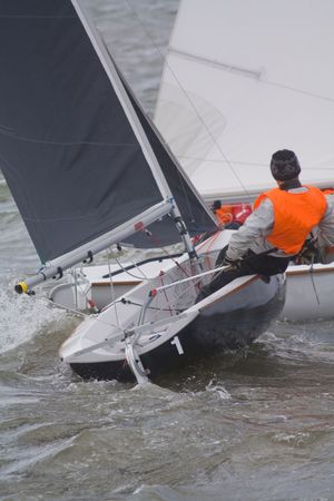 dingy: racing yachts competing on a lake