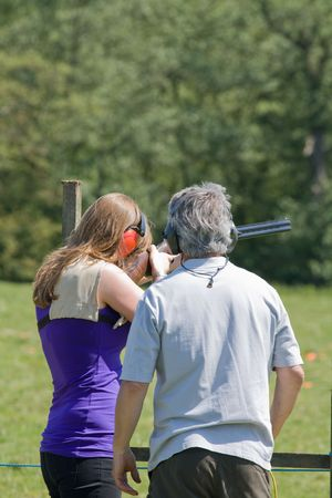 marksman: a lady being given tutition in using a gun