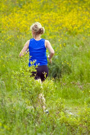 thou: a woman out jogging thou a long a countryside trail.