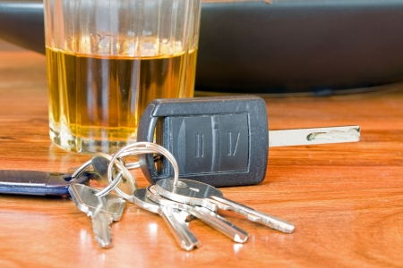 probation: drink driving concept image of car keys with alcohol Stock Photo