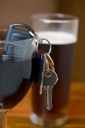 sobriety test: drink driving concept image of car keys with alcohol Stock Photo