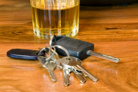 sobriety: drink driving concept image of car keys with alcohol Stock Photo