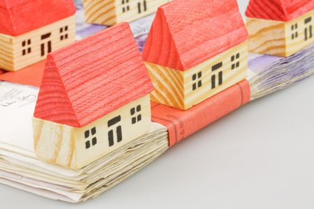 concep: cash with a wooden houses mortgage concep