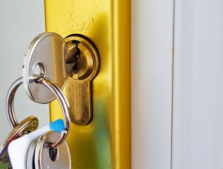 keys in the lock of a modern door mortgage concept photo