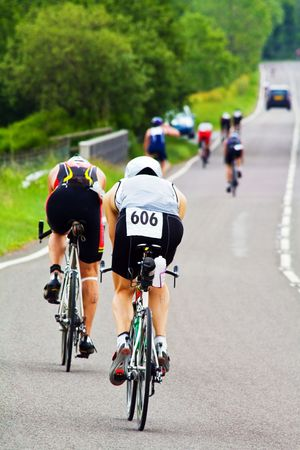 men cycling in a cycle race  photo