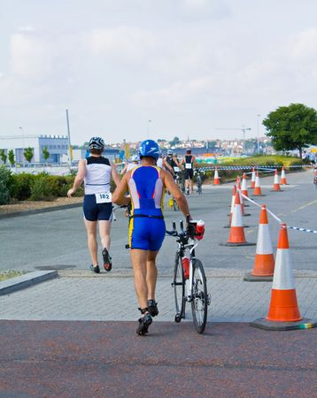 triathletes in the transition area of a triathlon  photo