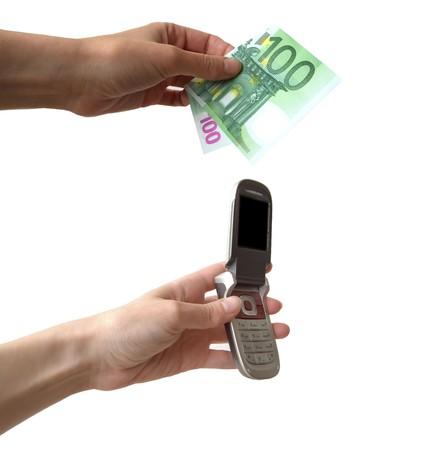 mani: mani con cellulare e soldi Stock Photo