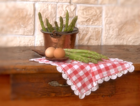 asparagus and eggs on wooden table