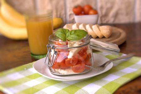 Caprese salad in a glass jar photo