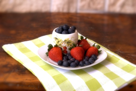 Strawberries and blueberries in season Stock Photo - 13330935